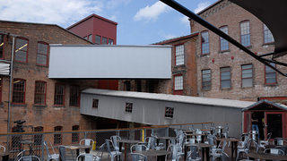 The buildings at MASS MoCA are connected with covered pedestrian walkways.