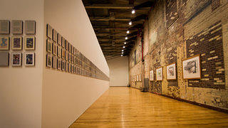 The historic brick walls add character to the modern exhibits.