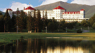 The Omni's noticeable red roof and backdrop of Mount Washington is the perfect spot for vacation. Credit: Omni Mount Washington Resort