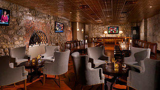 The furnishings have changed but The Cave still feels like a turn-of-the-century bar. Credit: Omni Mount Washington Resort