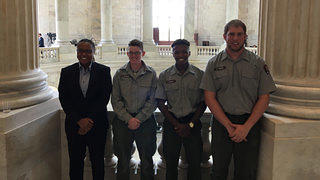 Former HOPE Crew members at the Senate building. Credit: Monica Rhodes