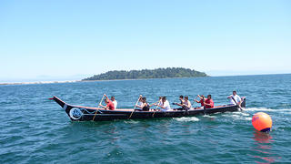 The Makah Tribe uses traditional canoes to travel between Tatoosh Island and Neah Bay.
