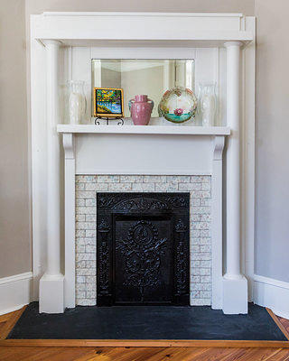 The fireplace mantel is decorated with objects from Drews' family. Credit: Peter Frank Edwards
