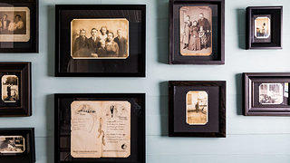 Old photographs of Drews' family hang on the wall. Credit: Peter Frank Edwards