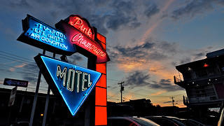 The Bel Air Motel's neon sign as seen by night.