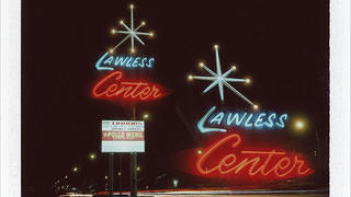 A double exposure shot of the Lawless Center.