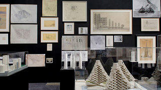 A salon-style display of drawings and models give viewers a crash course on Manhattan's most notable project to never break ground.