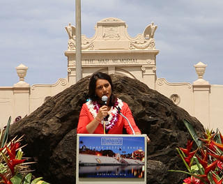Congresswoman Tulsi Gabbard speaking in front of the Waikiki Natatorium