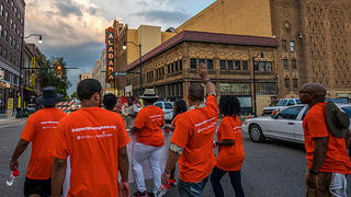 Demonstrators march to honor and recognize Birmingham's role in the Civil Rights Movement.