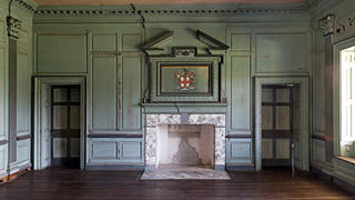 The upper great hall in Drayton Hall with original firebox and Corinthian pilasters.