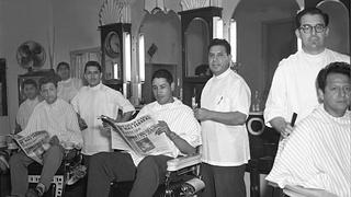 Fernando Estrella (center) in his barbershop, c. 1957.