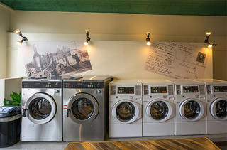 The walls behind the washers feature posters of historic photos of Kansas.