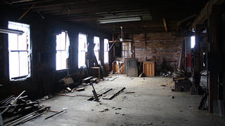 An interior room of the Hellman Creative Center prior to rehabilitation.