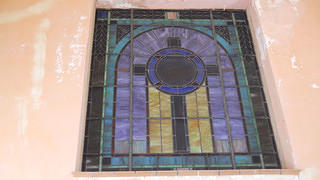 A stained glass window of St. Thomas Historic Residences.