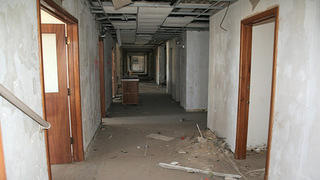A dilapidated hallway of St. Thomas Hospital.