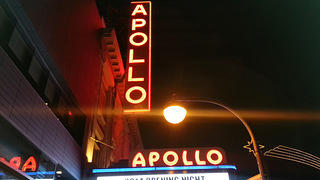 Apollo Theater's marquee and sign at night.
