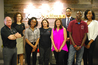 Interns Sanii Terry and Joshua Banks stand with employees at Klein & Hoffman. Credit: Klein & Hoffman