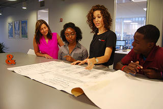Interns with Ryland and Burke look over blueprints. Credit: Klein & Hoffman
