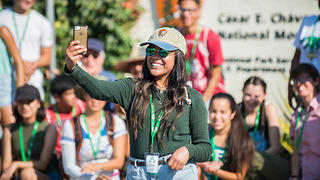 A student takes a selfie during the Youth Heritage Summit program.