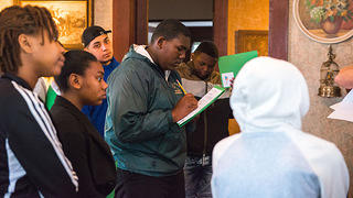 Students take a survey inside a historic site with the Proud of Where You Come From program.