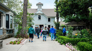 Students visit a historic house museum as part of the Proud of Where You Come From program.