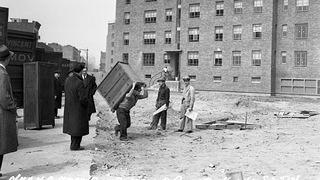 Moving in day at the still-unfinished East River Houses, April 1, 1941.