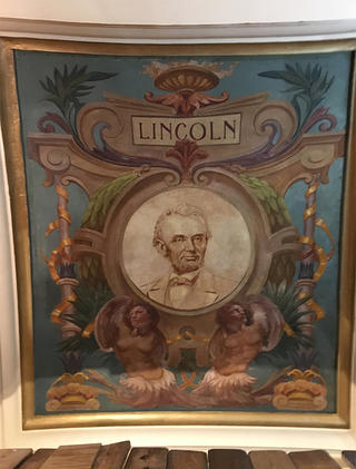 Abraham Lincoln's portrait is back to new after the conservation.
