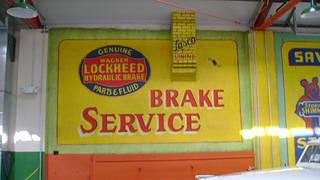 A wall sign inside Zip Auto.