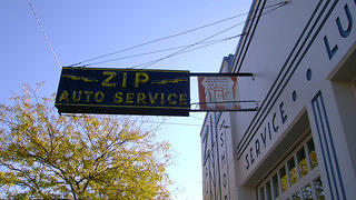 The neon sign of Zip Auto.