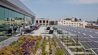 The solar panels and roof deck on the fifth floor of the building.