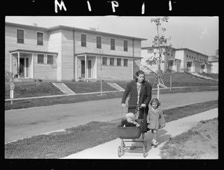 A mother walks her children down a Greenhills street in 1938, the year it opened to residents.