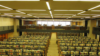 The rows of stacks and fluorescent lighting was hard to navigate.