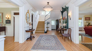 My elegant entryway with a turned staircase.