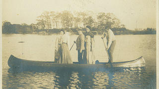 Florence and others in a canoe.