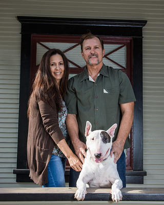 Hugh, his girlfriend and local business owner Christina, and their dog Tbone.