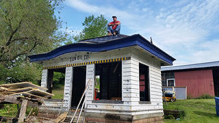 Hugh on top of the Sunoco station he is planning on revitalizing to create storage for the cottage homes.