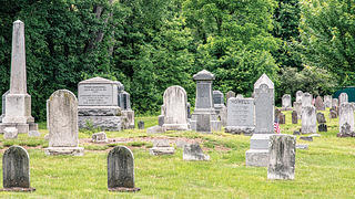 Markers at Whippany range from simple headstones to ornate obelisks and box tombs.