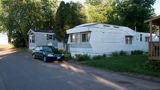 Side view of a mobile home in the Hilltop Mobile Home Community.