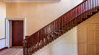 The elegant staircase was considered exceptional by contemporaries.
