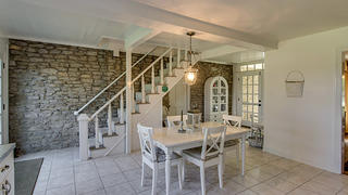 My immaculate white kitchen leads to the stone staircase to the second story.