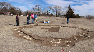 East view of ring number 18 at the Pawnee Tipi Rings Site, showing people for scale.