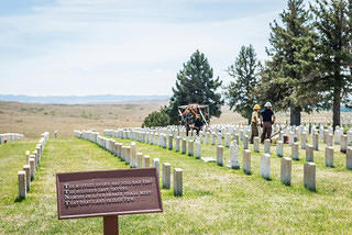 View of Custer National Cemetery with interpretive sign