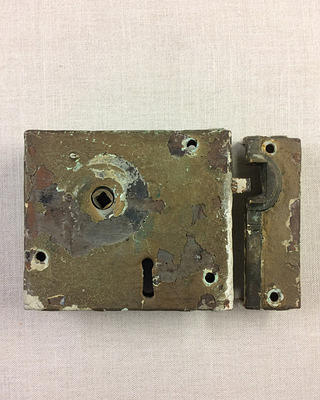 "Lock found on the exterior doors, with the lettering ""Carpenter Patentee."""