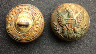 Buttons found between 1854-1875 under the windowsill in the small upstairs bedroom.
