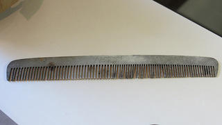 Aluminum Comb found late 19th to mid-20th century during repairs in the upstairs bedroom.