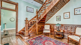 My elaborate staircase hints at the richness of my many interior wood details.