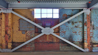 The layers of history on the brick walls.