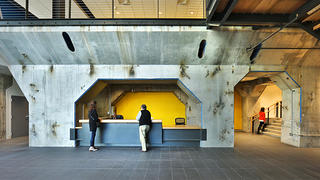The concrete at reception seem larger than life, but the design brings it down to human scale.