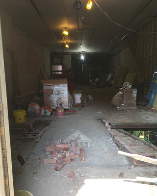Debris and gutted interior of Phase One, June 2018.