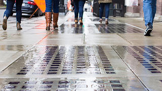 A sidewalk containing glass prisms.